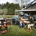 glamping by Camp Champ outdoor kitchen with a couple by a lake