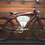 electric bike by Vintage with a marron bike and a wood background