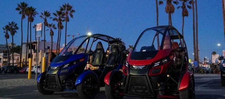 Arcimoto electric vehicles a red and blue electric vehicle parked on a street in california