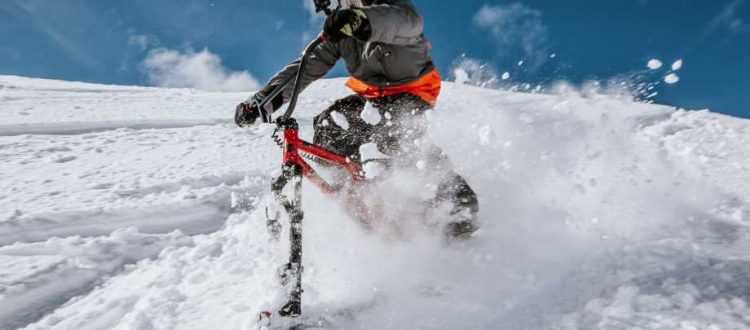 skiing winter toys feature Hillstike a skiing bike shooting down a snow covered hill