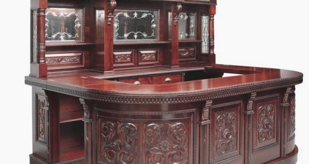 luxury home bars by Jeres features a beautiful wood bar with a glass back