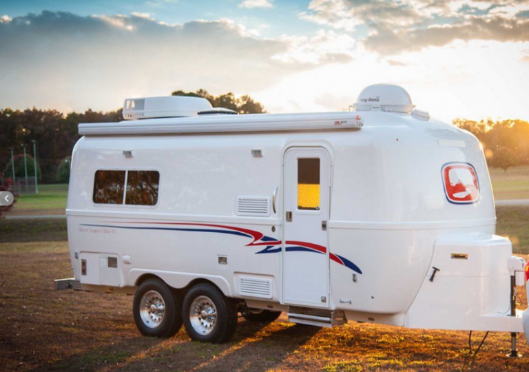 camping a white camper by Oliver Travel Trailers