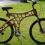 bicycles by Riderwood a wood bike standing on the lawn