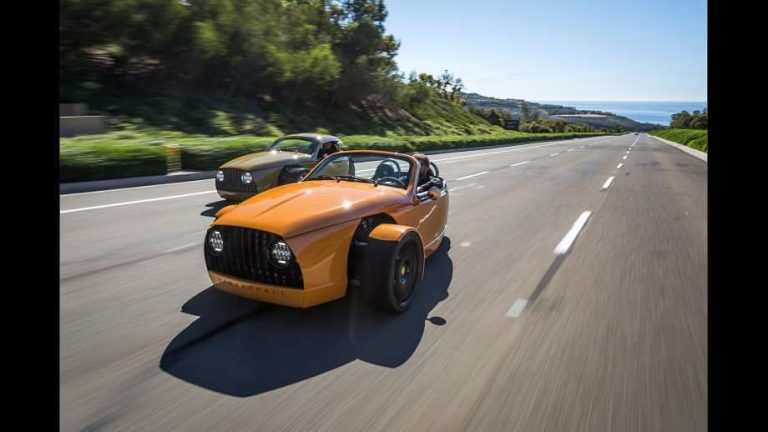 Small electric vehicles featuring an orange roadster by Vanderhall