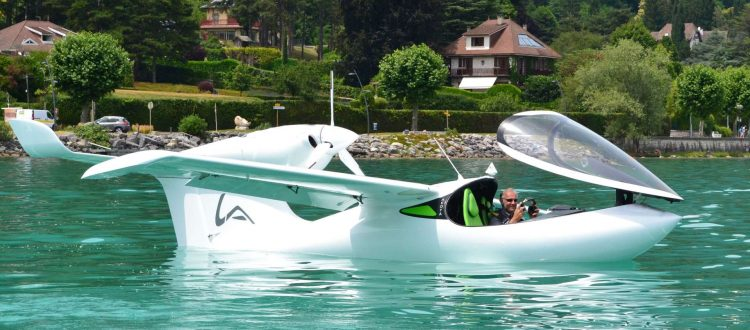 amphibious aircraft by Lisa Akoya floating in a body of water