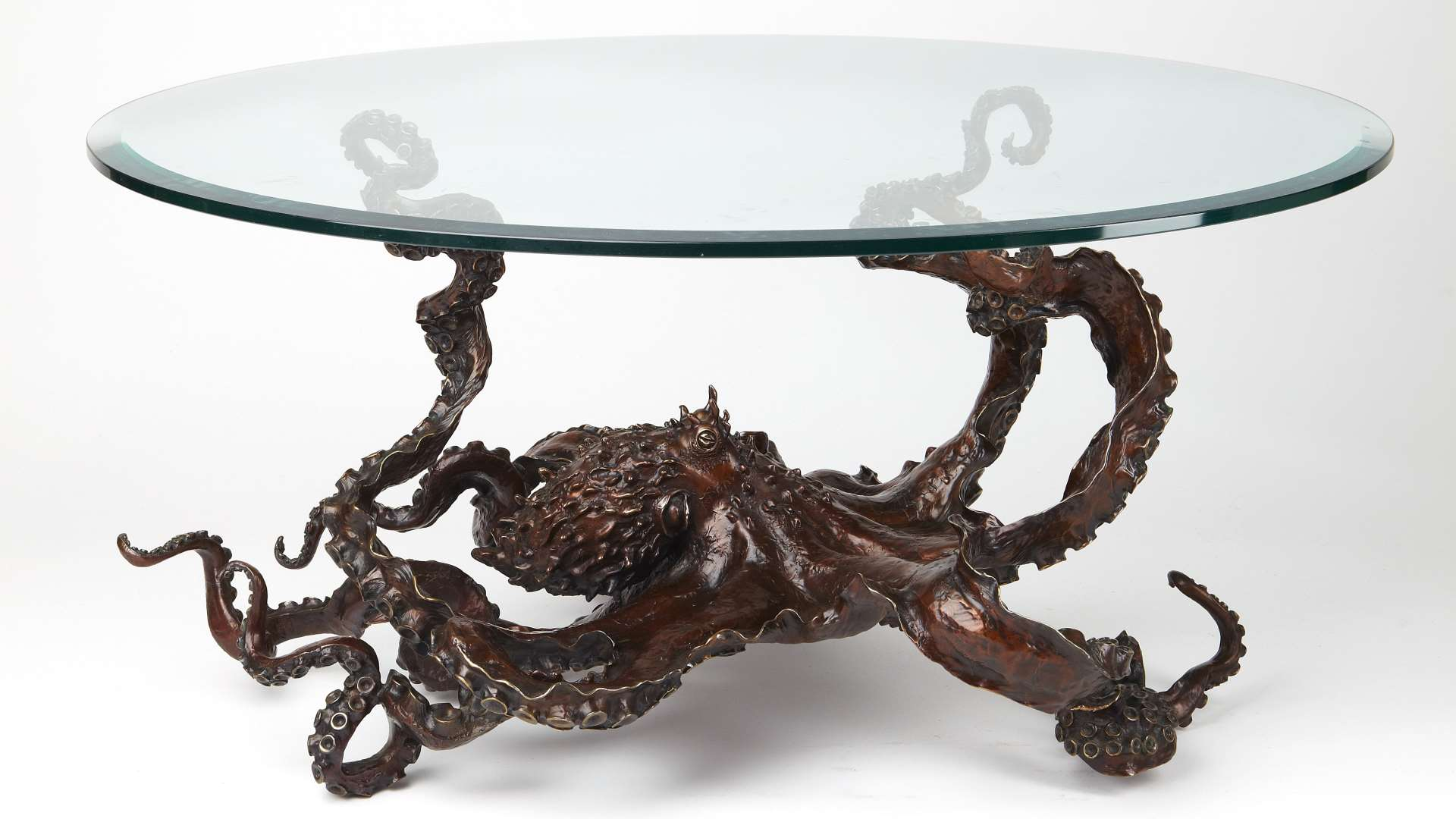 luxury furniture by Kirk McGuire a bronze octopus glass table