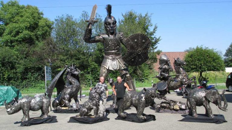 art by recycle art features a warrior and several other statues made from used automotive parts