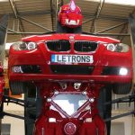 Letrons Transformers shows a red transformer in a warehouse