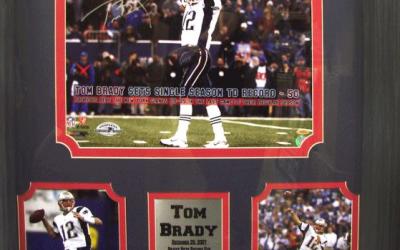 sports memorabilia by Encore Select shows Tom Brady celebrating a victory