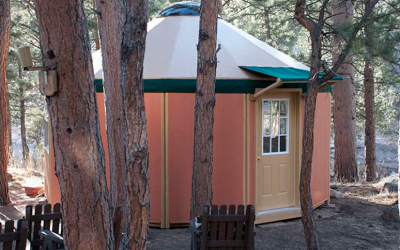 glamping showing yurt cabins on a body of water