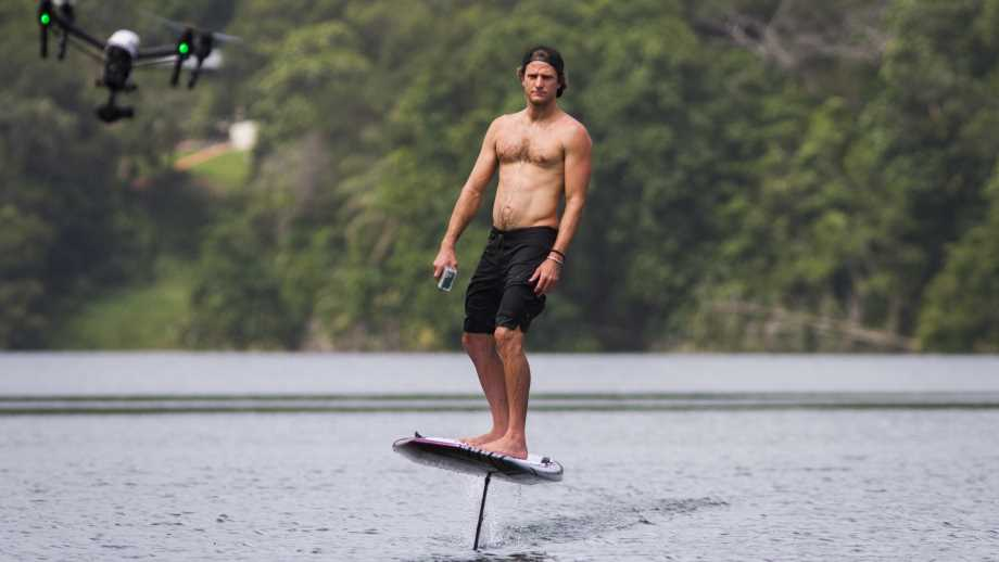 efoil surfboard by lift foils on a body of water with a drone and a mountain