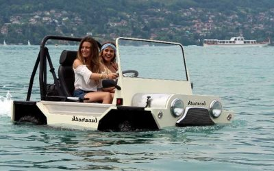 Moke Amphibious vehicle in a body of water with 2 girls in the carls