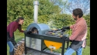 TOTO Grilloven with people grilling outdoors