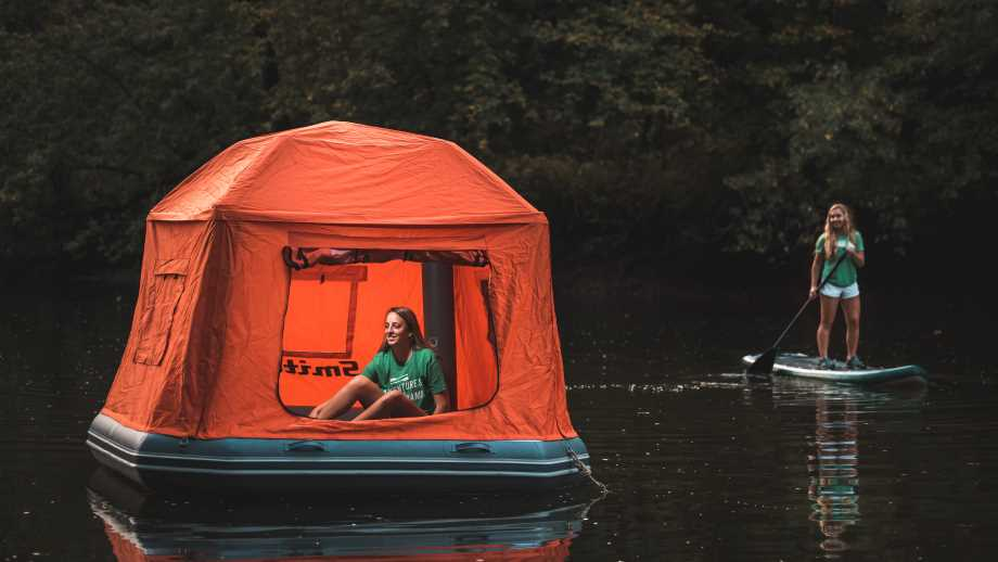 Floating tents by smithfly on the water with a paddleboarder